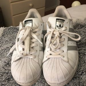 Adidas superstar shoes; silver detail